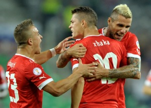 Xhaka of Switzerland celebrates scoring a goal with team mates Shaqiri and Behrami during their World Cup 2014 qualifying soccer match against Slovenia in Ljubljana