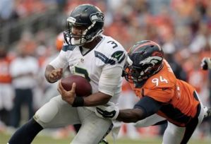 russell-wilson-demarcus-ware-ea1a9dc59d5b9ae3